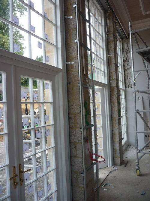 Image 79 - Columns formed in Gypliner metal between 4m high door openings in a brand new Orangery