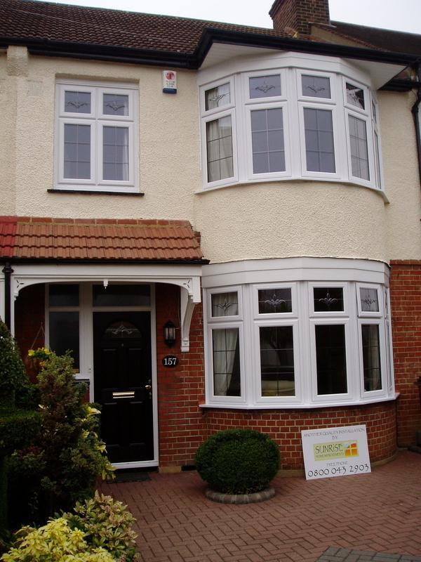 Image 35 - White upvc windows and black composite door with glass bevels and aged lead