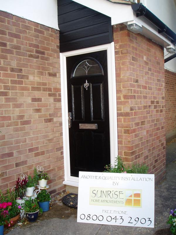 Image 7 - Black composite door & cladding top