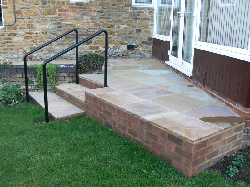 Image 6 - raised patio area  with steps and handrail
