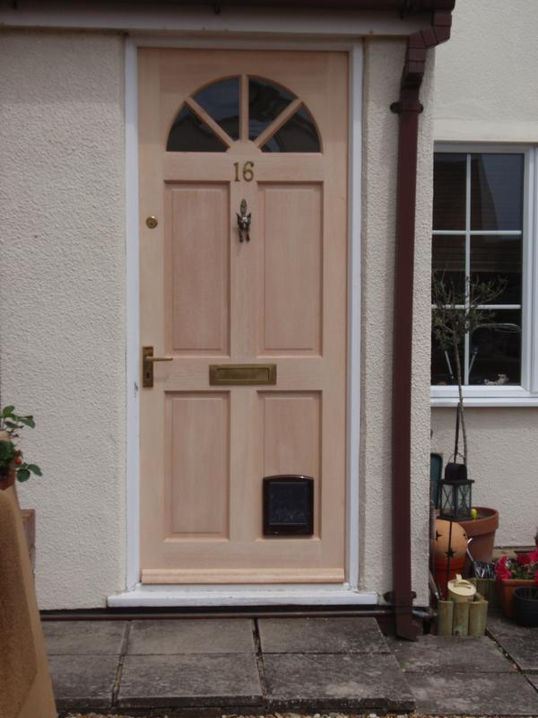 Image 61 - Front door fitted with existing hardware.