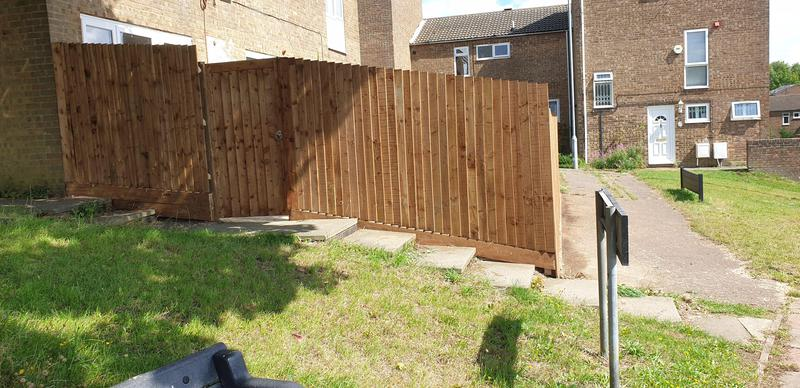 Image 6 - feather edge/close board fencing sloping down plus a gate to suit