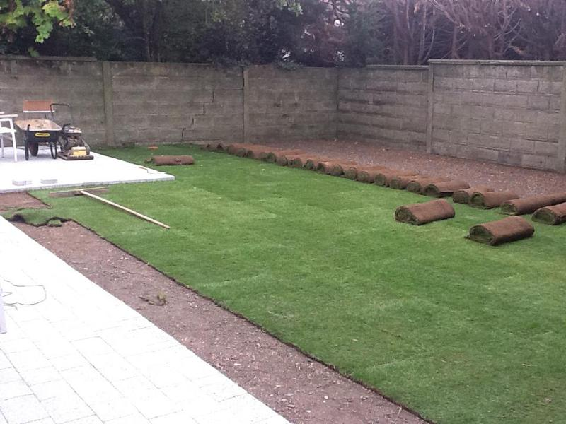 Image 11 - We are laying the turf level with the patio we have just finished