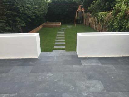 Image 27 - White rendered wall/flowerbeds, slate grey paving