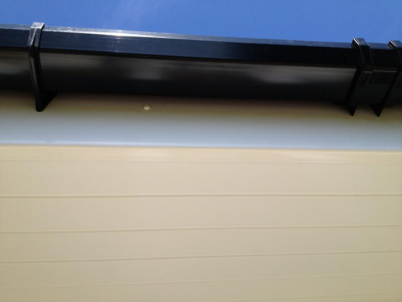 Image 8 - Black half round guttering on new white fascia. T & G soffit in white