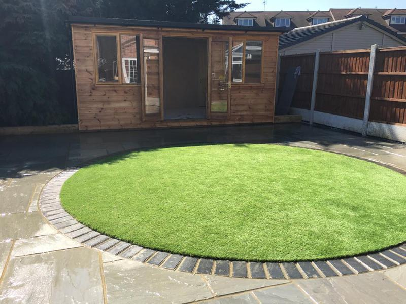 Image 3 - Bespoke outbuilding, artificial lawn and patio