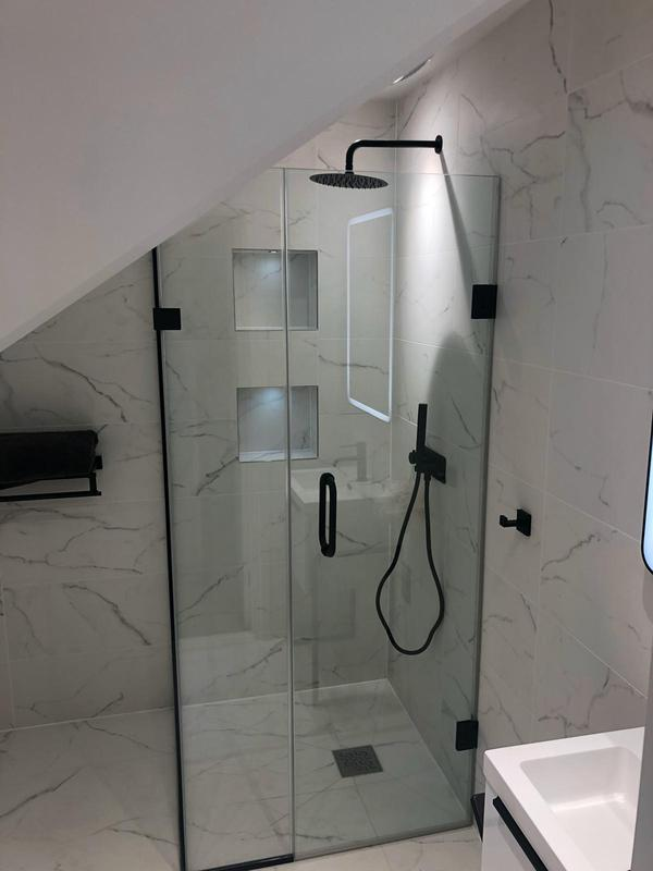 Image 43 - This simply beautiful black and white en suite was designed by the customer with recess added into the shower for extra storage.