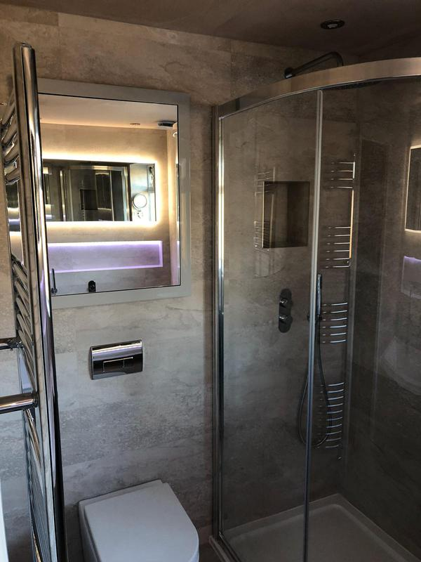 Image 28 - A beautiful shower room with a wall hung toilet and large shower in a family bathroom.