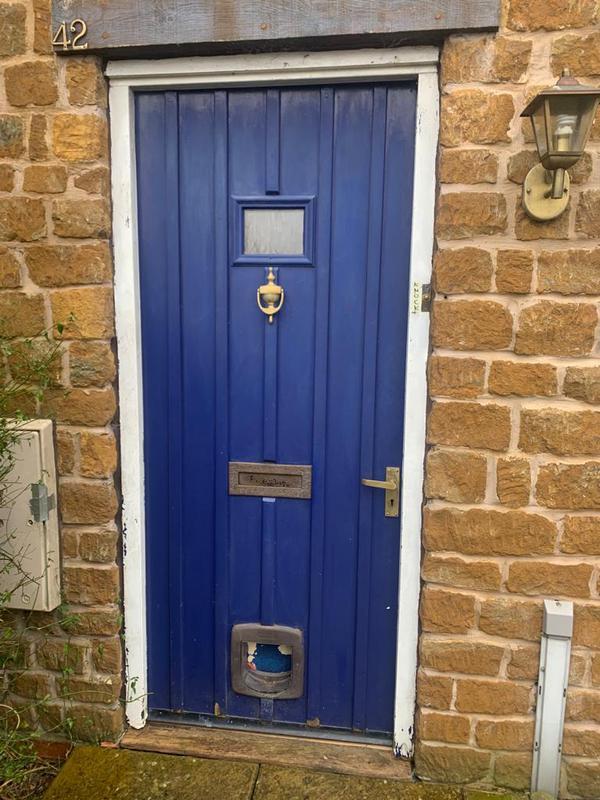 Image 2 - Before - door in need of replacement.