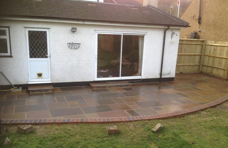 Image 7 - Stone blend Patio with brick edging & close board fencing