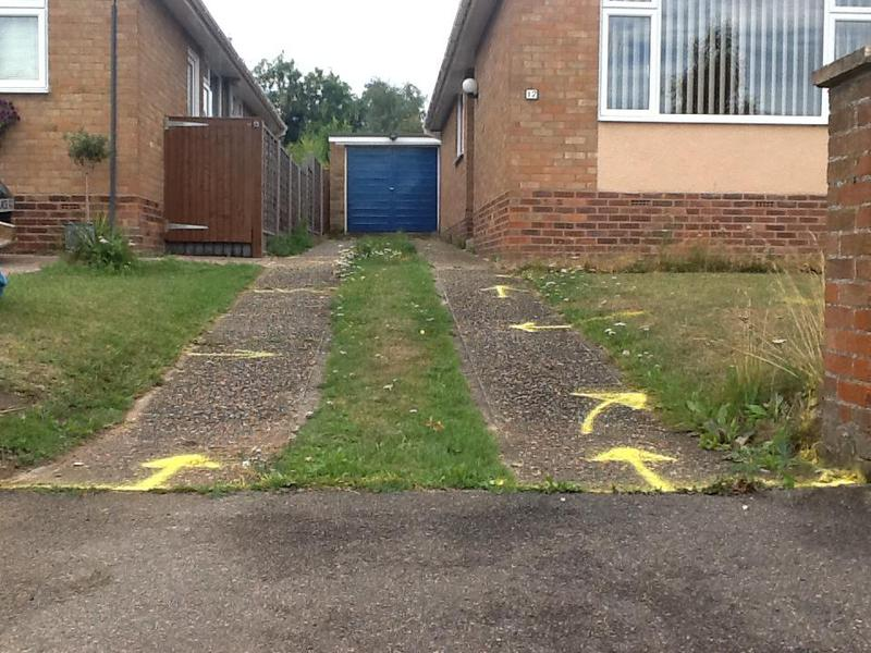 Image 4 - Please note the two different levels from the garage to the road