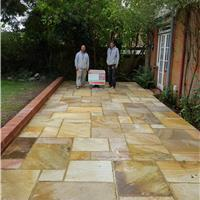 Image 28 - A 9inch wall in stock bricks with fossil indiann sandstone patio in canterbury