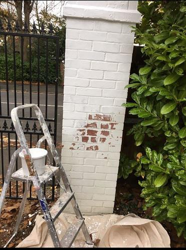 Image 1 - giving gate pillars a coat to freshen them up