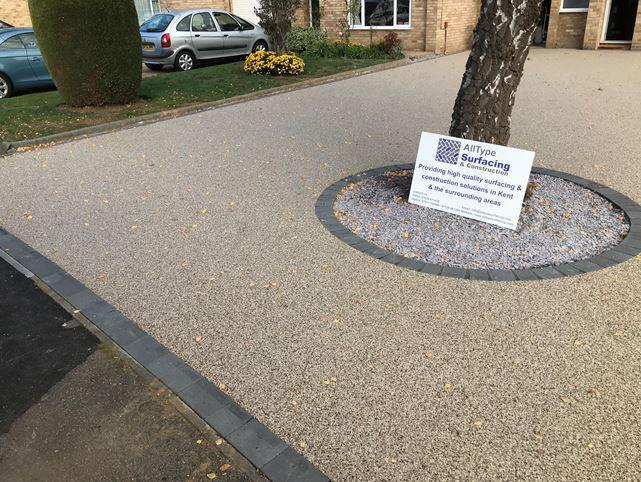 Image 21 - Resin driveway with charcoal border and tree pit surround.