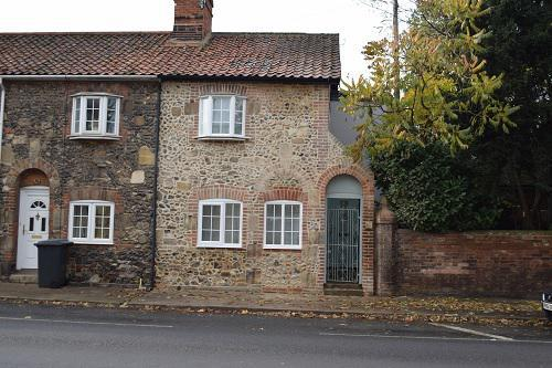 Image 9 - As this picture shows the finished project on the property on Bury St Edmunds , where the door has been replaced with a window and flint work completed to match , the front of the house was re pointed in lime
