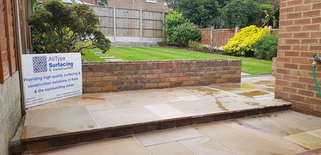 """Image 23 - Garden re-design. New patio area, planters created using 4"""" brickwork and new lawn with stepping stones"""