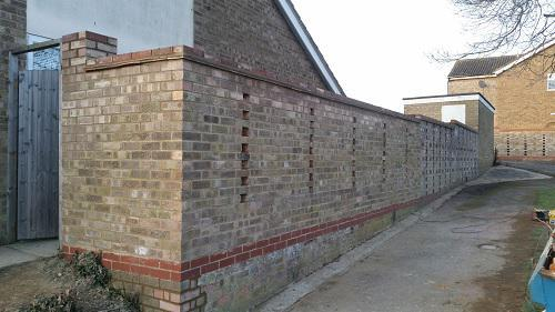 Image 16 - After picture of rebuilt wall