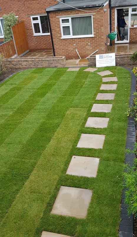 Image 25 - Picture showing the new lawn with stepping stones. The border around the lawn is created using charcoal blocks and gives a nice clean finish. It also aids cutting of the lawn too.