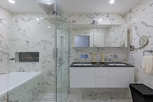 Image 62 - Refurbished bathroom and fitted marble tiling on floor and ceiling