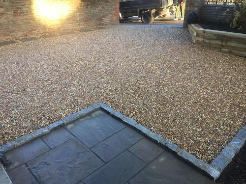 Image 17 - Gravel driveway with Granite setts & Indian Sandstone pathways with wooden sleeper walls in Guildford