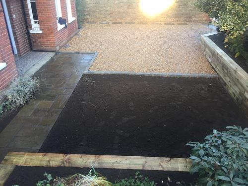 Image 18 - Gravel driveway with Granite setts & Indian Sandstone pathways with wooden sleeper walls in Guildford