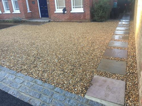 Image 19 - Gravel driveway with Granite setts & Indian Sandstone pathways with wooden sleeper walls in Guildford