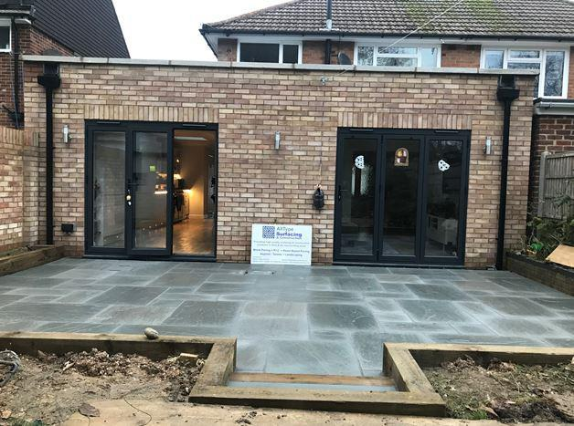 Image 31 - New patio area formed using grey sandstone slabs and timber sleepers