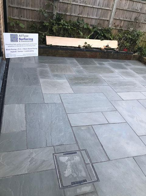 Image 34 - This patio had to have two recessed manholes installed. When installing these manholes its key to ensure the pattern of the paving is maintained.