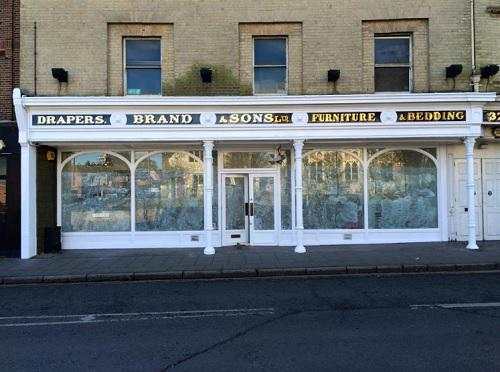 Image 24 - gold leaf lettering repair with white weathershield exterior