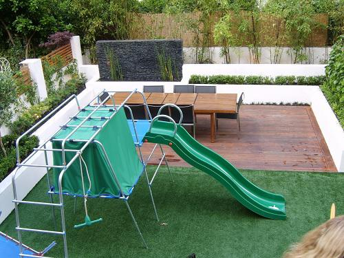 Image 50 - Built brickw all and added a water feature and plants. Decking on lower level and turfed the upper level