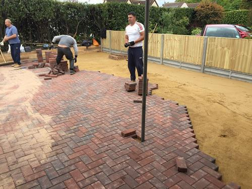 Image 34 - Block paving driveway with wooden sleeper walls in Mayford