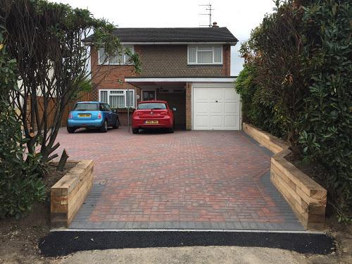 Image 35 - Block paving driveway with wooden sleeper walls in Mayford