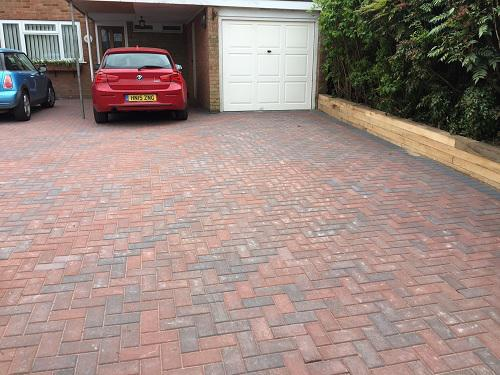 Image 36 - Block paving driveway with wooden sleeper walls in Mayford