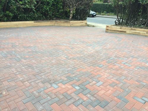 Image 40 - Block paving driveway with wooden sleeper walls in Mayford