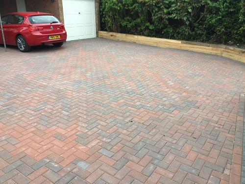 Image 41 - Block paving driveway with wooden sleeper walls in Mayford