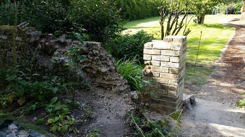 Image 11 - this is a before picture of a flint wall that was in need of rebuild/ repair