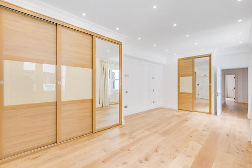 Image 54 - Bespoke sliding wardrobes, fitted oak flooring. Fitted ceilig lights to bring more light into the room. Fitted made to measure curtains and privacy blinds