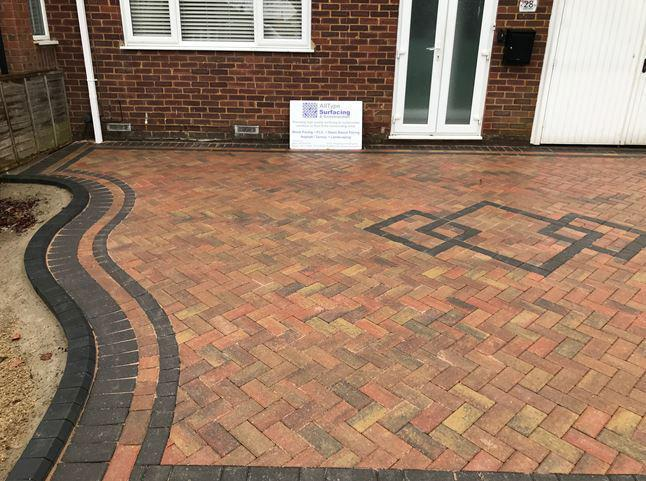 Image 18 - Block paved driveway using autumn gold coloured blocks along with charcoal border. Low charcoal keykerbs used to form planter area.