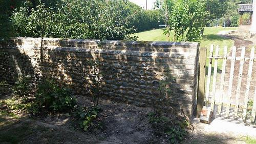 Image 11 - this shows the finished flint wall having been rebuilt