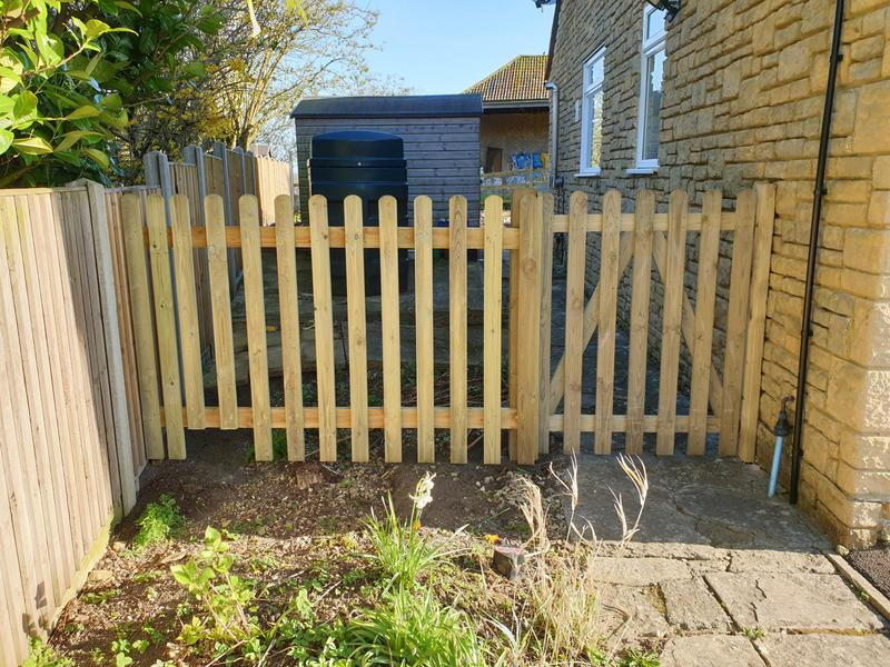 Image 190 - Picket gate and fencing with cut out for hedgehog access