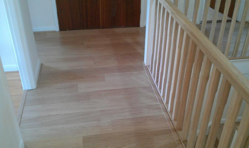Image 27 - Quickstep laminate flooring to landing bars and scotia to match.