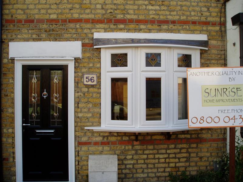 Image 34 - White upvc plant on bay window,with black composite door