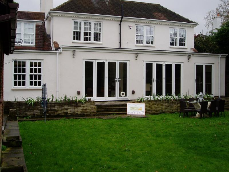 Image 31 - Sliding sash windows and bifolding doors white upvc