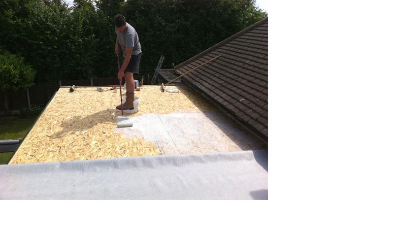 Image 3 - The fleeced back EPDM is stuck down with deck glue.