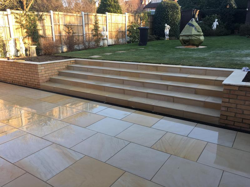 Image 1 - Sawn honed mint sandstone patio with steps, retaining brick wall