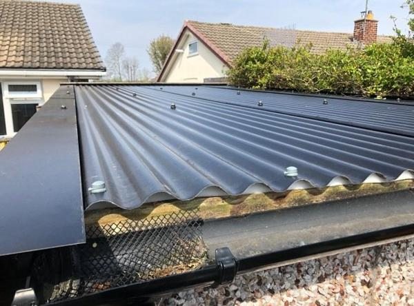 Image 12 - Example of an asbestos roof we have removed and replaced with this classic black sheeting and fascia