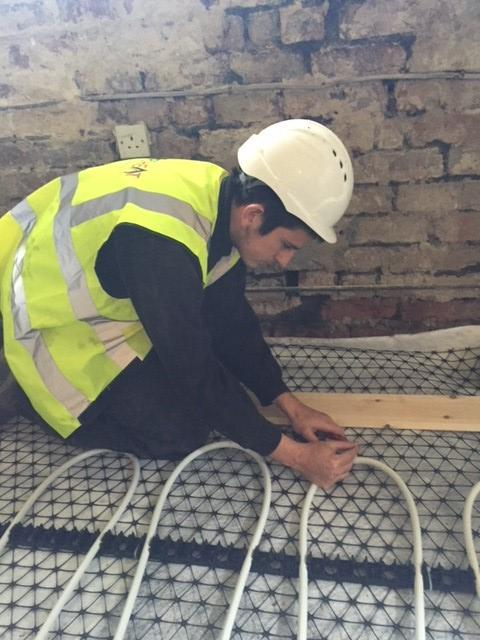 Image 7 - Working hard on an underfloor heating installation