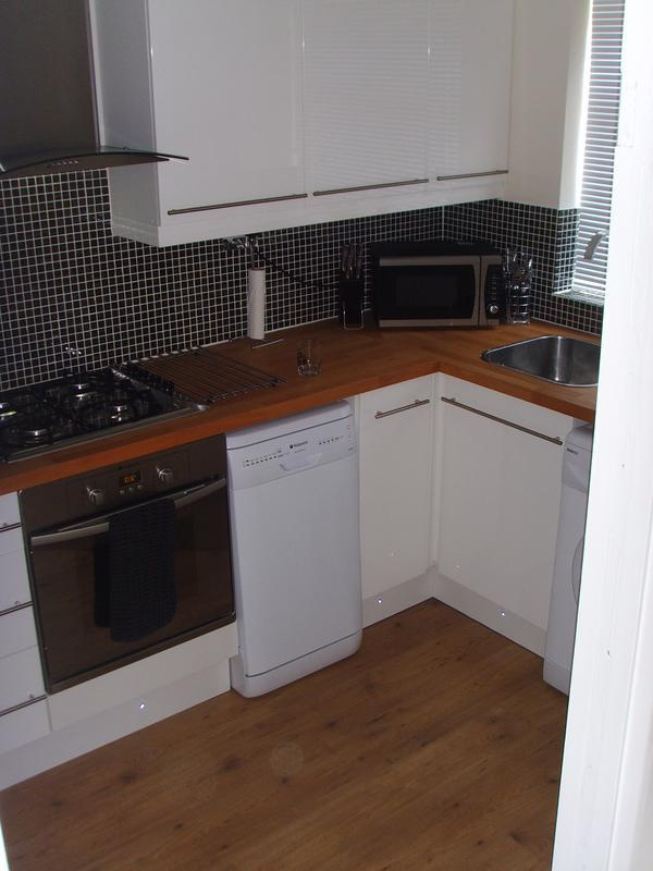 Image 56 - High gloss white kitchen with solid beech top