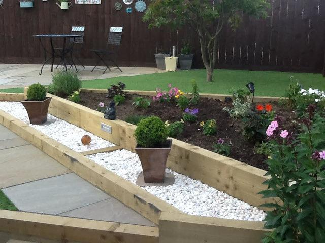 Image 27 - Artificial Turf, wooden sleeper planting areas, Spanish white gravel