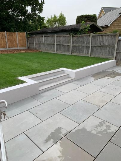 Image 7 - Grey Smooth sandstone with white rendered wall
